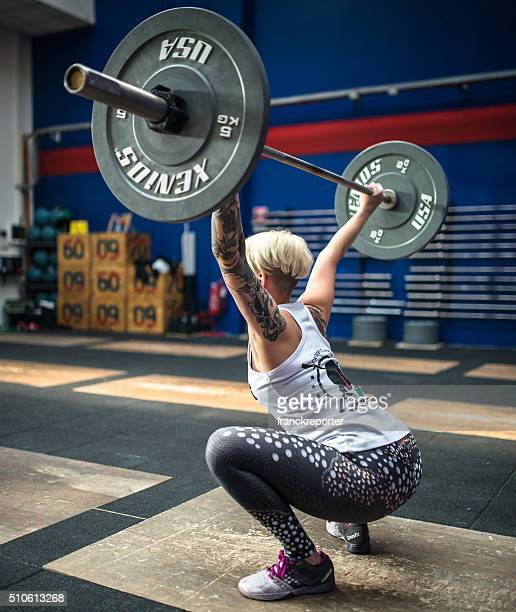 woman weightlifting on a gym  gym