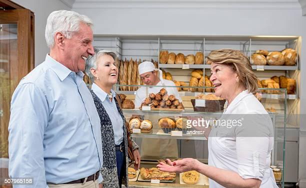 Woman welcoming customers to the bakery