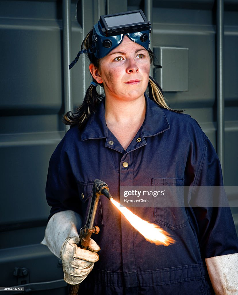 Woman Welder with a Flaming Torch : Stock Photo