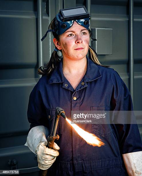 Woman Welder with a Flaming Torch