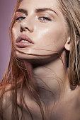 woman wet face in beige colors