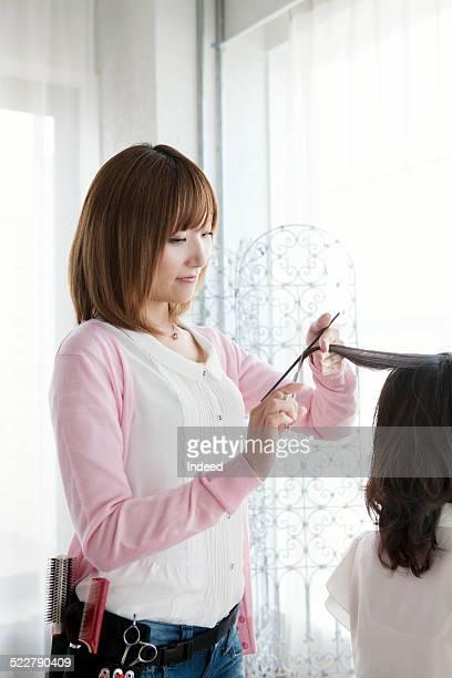 A woman who cuts hair