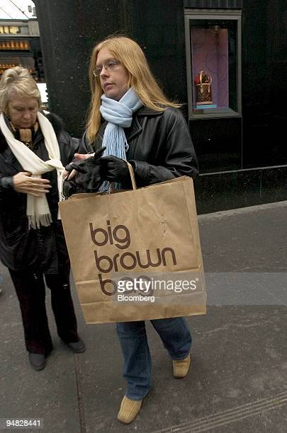 A woman who declined identification walks with a Bloomingdale's bag outside their flagship store in New York on February 28 2005 Federated Department...