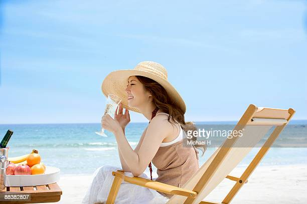 Woman who drinks champagne on beach