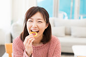 young attractive asian woman who eats