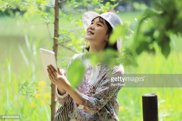 woman who enjoys nature while operating a table laptop computer