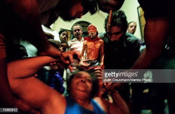 A woman who has fallen into a trance is assisted by others during the centuriesold annual pilgrimage to the Iglesia De San Lazaro on the Day Of Saint...