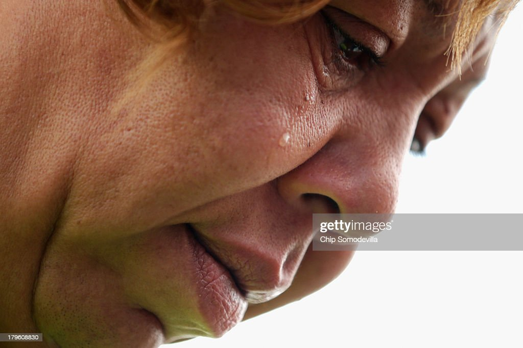 A woman who identified herself only as Tonya C, cries after telling demonstrators how she was fired from a Walmart store during a pro-labor rally outside a Walmart store September 5, 2013 in Hyattsville, Maryland. About 225 people gathered outside the Walmart store to protest the retail giant's labor practices A showdown continues between Walmart and the neighboring District of Columbia, where Mayor Vincent Gray could sign a bill that would make large retailers to pay their employees a 50 percent premium over the city's minimum wage.