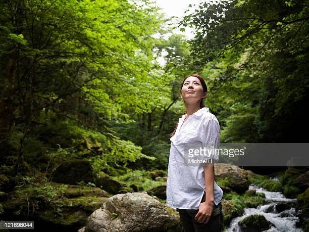 Woman who is enjoying beautiful nature in forest