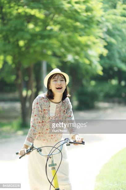 woman who is getting comfortable in a bicycle