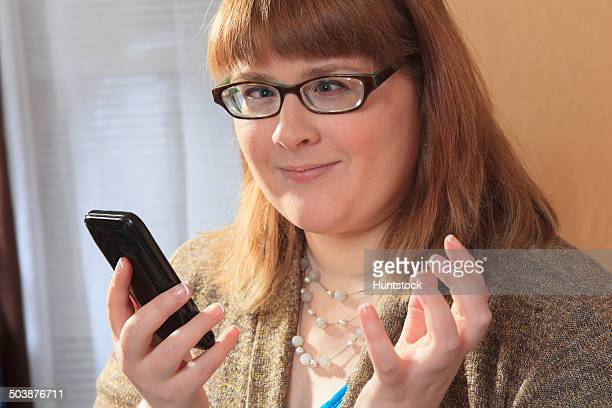 Woman who is legally blind using her smart phone