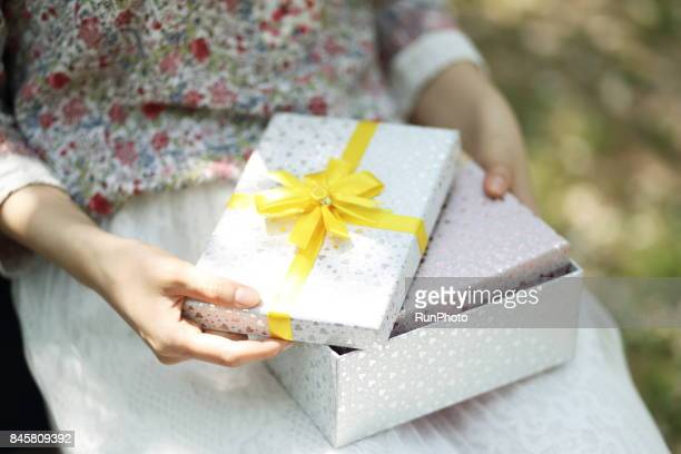 woman who is opening a gift box