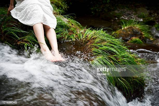 Woman who is soaked to beautiful river