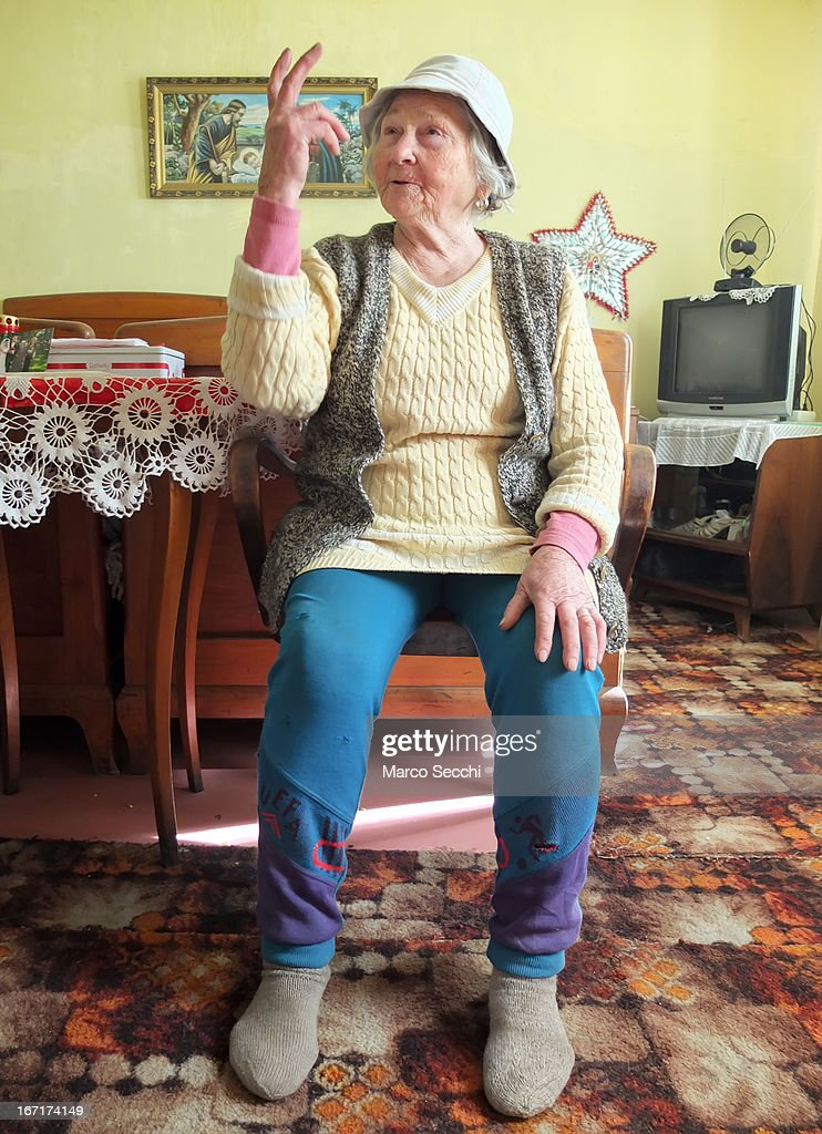 A woman who lives in the outskirt of the city poses for a picture inside her bedroom on April 16, 2013 in Timisoara, Romania. Romania has abandoned a target deadline of 2015 to switch to the single European currency and will now submit to the European Commission a programme on progress towards the adoption of the Euro, which for the first time will not have a target date.