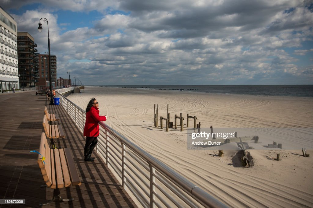A woman who only identified herself as Gigi looks out to see from the Long Beach boardwalk on October 25, 2013 in Long Beach, New York. The Long Beach boardwalk was severely damaged by Superstorm Sandy last year, which killed 285 people and caused billions of dollars in damage, though the boardwalk reopened today. Long Beach's new boardwalk is made of Brazilian hardwood and is estimated to have a lifespan of 30-40 year; the previous boardwalk was only scheduled to last three to seven years.