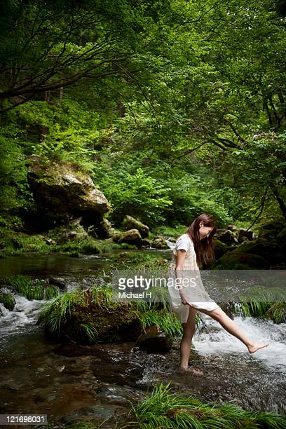 Woman who plays happily by one person in river