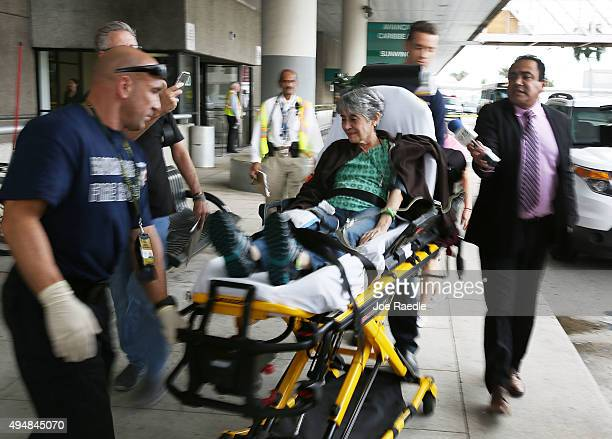 A woman who was on the Caracas Venezuelabound Dynamic International Airways Boeing 767 that caught fire is transported by Broward County Sheriff Fire...