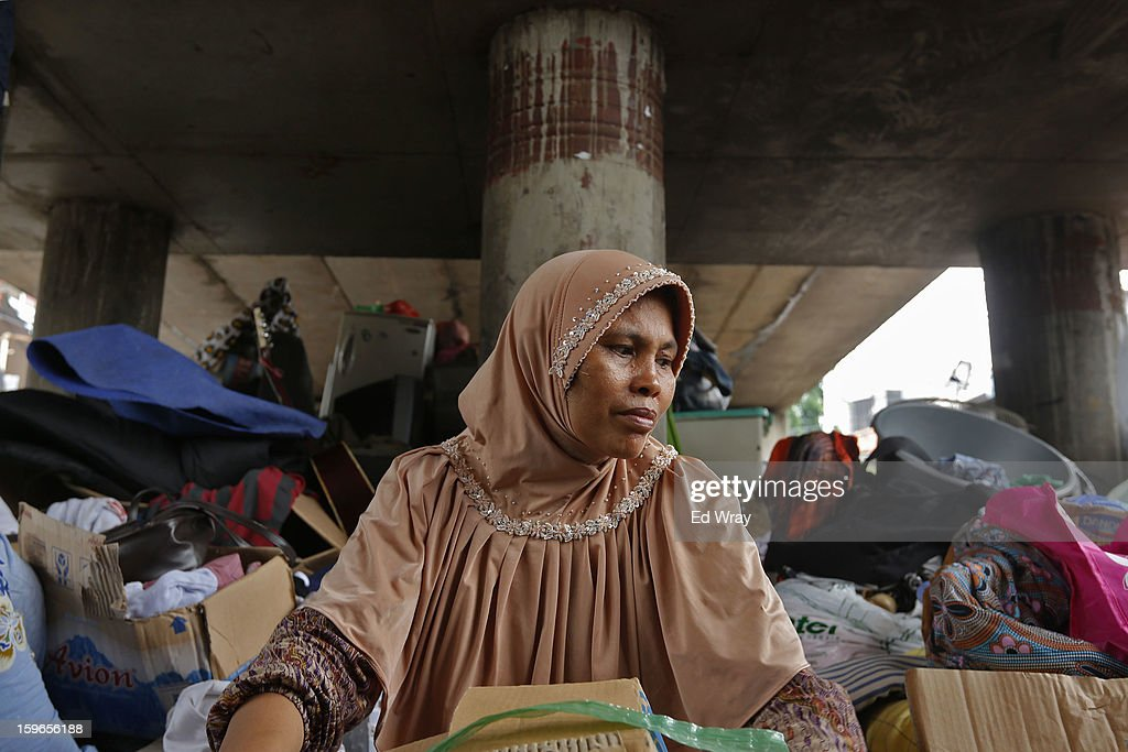 A woman, whose home has been flooded, sits among salvaged household goods at a temporary refuge under a highway flyover on January 18, 2013 in Jakarta, Indonesia. According to the National Disaster Management Agency, about 50 percent of the capital is under water following the floods which have so far claimed eleven lives and displaced thousands of Indonesians.