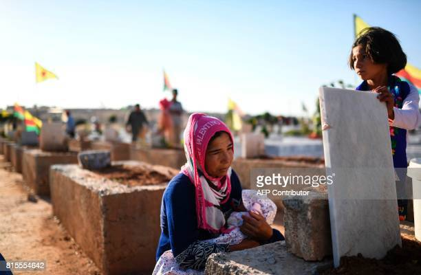 A woman whose husband was killed in the USbacked Kurdish and Arab forces' battle of Raqa the main Syrian stronghold of the Islamic State group visits...