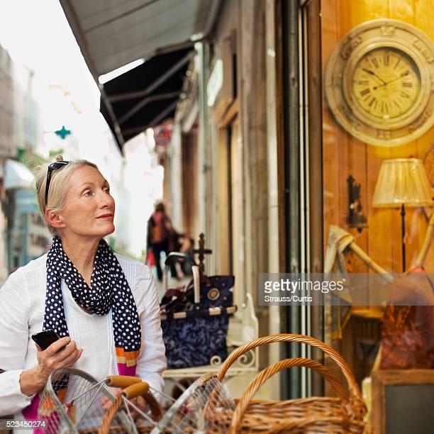 Woman window shopping, Carcassonne, France