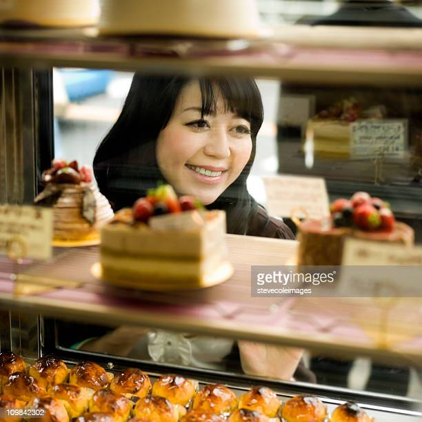 Woman Window Shopping for Pastries