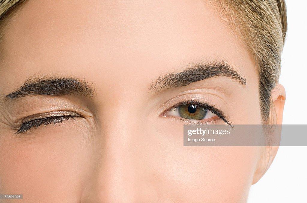 Woman winking : Stock Photo