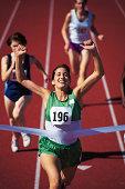 Woman winning race at track meet