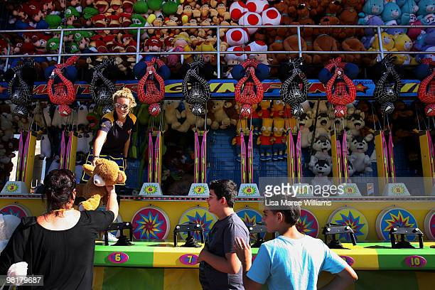 A woman wins a teddy bear in sideshow alley at the Royal Easter Show at the Sydney Showground on April 1 2010 in Sydney Australia This year will be...
