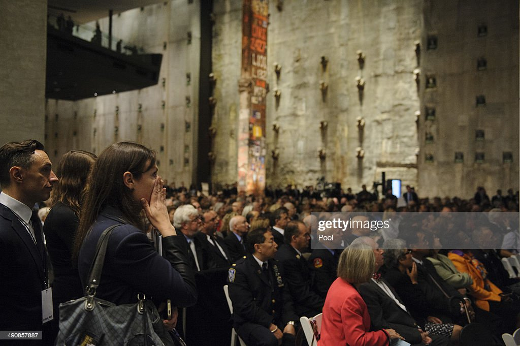 A woman wipes away tears during the opening ceremony for the National September 11 Memorial Museum at ground zero May 15, 2014 in New York City. The museum spans seven stories, mostly underground, and contains artifacts from the attack on the World Trade Center Towers on September 11, 2001 that include the 80 ft high tridents, the so-called 'Ground Zero Cross,' the destroyed remains of Company 21's New York Fire Department Engine as well as smaller items such as letter that fell from a hijacked plane and posters of missing loved ones projected onto the wall of the museum. The museum will open to the public on May 21.
