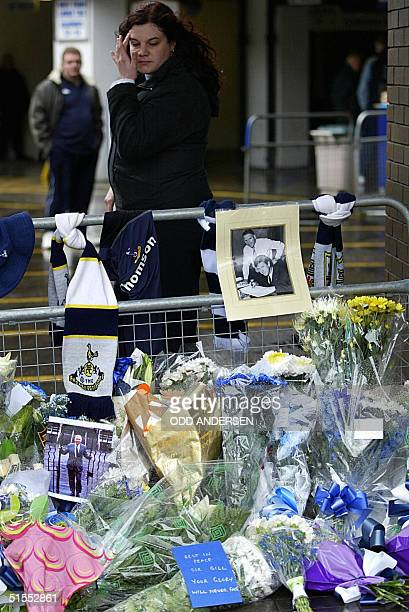A woman wipes her eye as she pays her last respects to former legendary Tottenham manager Bill Nicholson at a makeshift memorial at the White Hart...