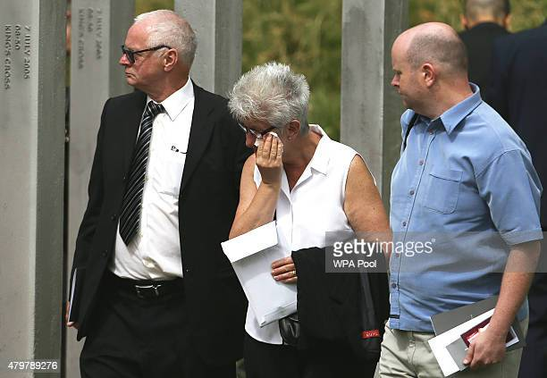 A woman wipes her eyes as she walks through the July 7 memorial in Hyde Park during a service to commemorate the tenth anniversary of the London 7/7...