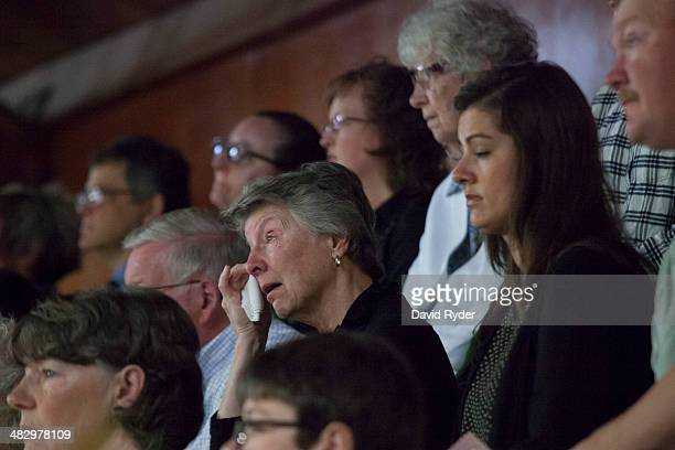 A woman wipes tears from her eyes during a memorial service for Linda McPherson a beloved member of the community and a former librarian at the...