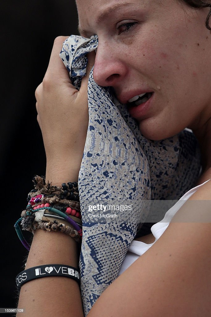 A woman wipes tears from her eyes during the Bali Bombing 10th anniversary ceremony held at Garuda Wisnu Kencana on October 12, 2012 in Jimbaran, Bali Indonesia. Hundreds of family members, friends and general public gathered to remember the victims of the 2002 Kuta nightclub bombings which killed 202 people, including 88 Australians.