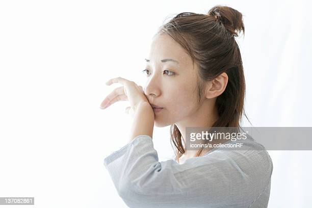 Woman wiping her mouth with her hand, Tokyo Prefecture, Japan