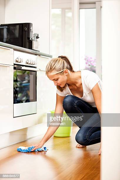 Woman wiping the floor in kitchen