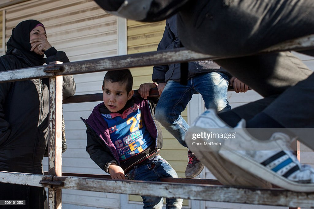 A woman wishing to return to Syria waits in line with children to pass through a border gate as a small number of Syrian refugees were allowed to return to Syria at the closed Turkish border gate on February 9, 2016 in Kilis, Turkey. According to Turkish officials some 35,000 Syrian refugees have massed on the Syrian/Turkish border after fleeing Russian airstrikes and a regime offensive surrounding the city of Aleppo in northern Syria.Ê Turkey's President Recep Tayyip Erdogan said Turkey would open it's doors' if necessary'