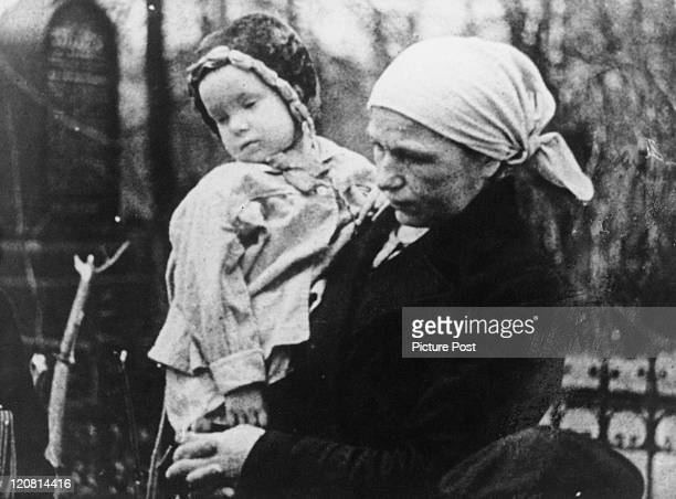 A woman with a baby in Leningrad during the Siege of Leningrad later Saint Petersburg World War II 1942 Original Publication Picture Post 1337 What...