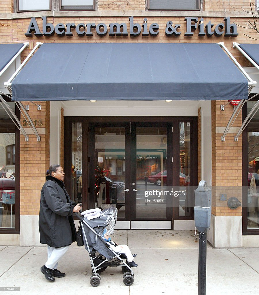 A woman with a baby stroller passes an Abercrombie & Fitch clothing store December 8, 2003 in Chicago, Illinois. A recent report claims that Abercrombie & Fitch discriminates against sales representatives based on their 'attractiveness.' They have also decided to remove its Christmas catalog, which some claim featured sexually explicit images, from its store shelves.