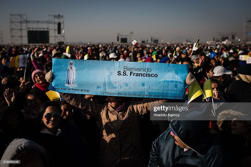 A woman with a banner is seen before the mass of Pope Francis in Ecatepec in his Pastoral Visit to Mexico in Ecatepec, Mexico on February 14, 2016.