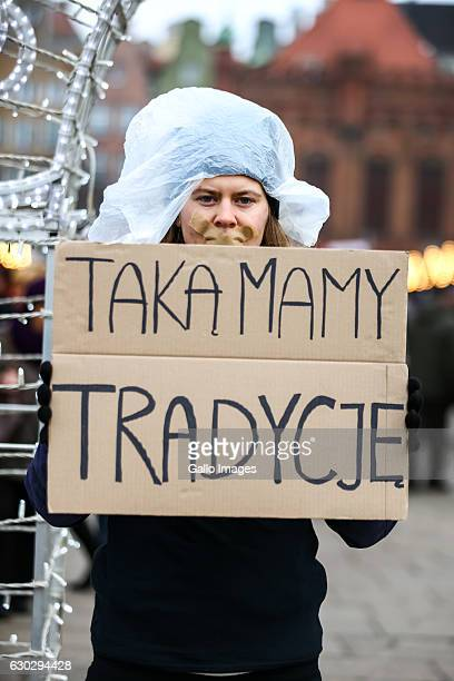 A woman with a banner participates in the social action against bloody Christmas on December 18 2016 in Gdansk Poland The movement is opposed to the...