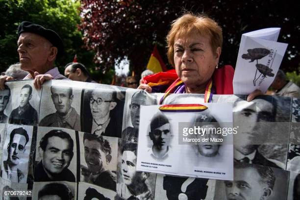 A woman with a banner showing missing relatives during the war in the commemoration of the Garden of the fighters of 'The Nine' the battalion of...