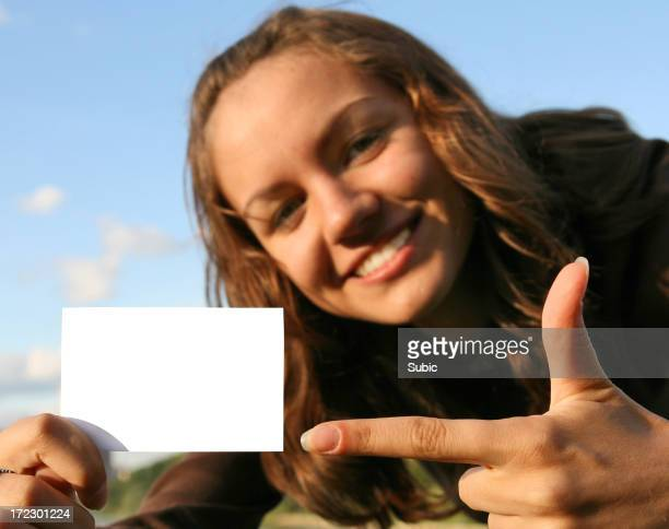 A woman with a blank business card