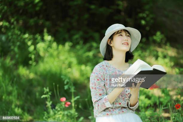 woman with a book in the park