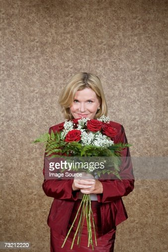 Woman with a bunch of flowers : Stock Photo