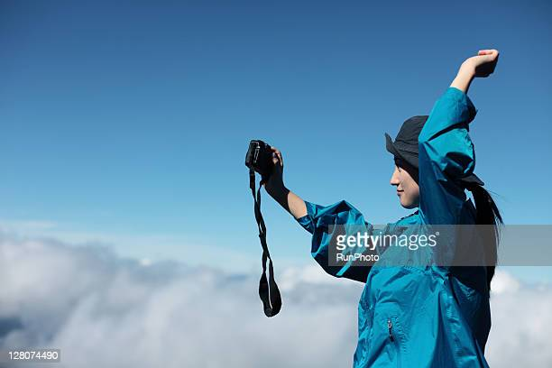 woman with a camera at the mountain