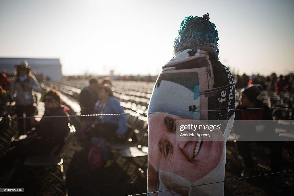 A woman with a coat with the picture of the Pope Francis is seen before the mass of Pope Francis in Ecatepec in his Pastoral Visit to Mexico in Ecatepec, Mexico on February 14, 2016.