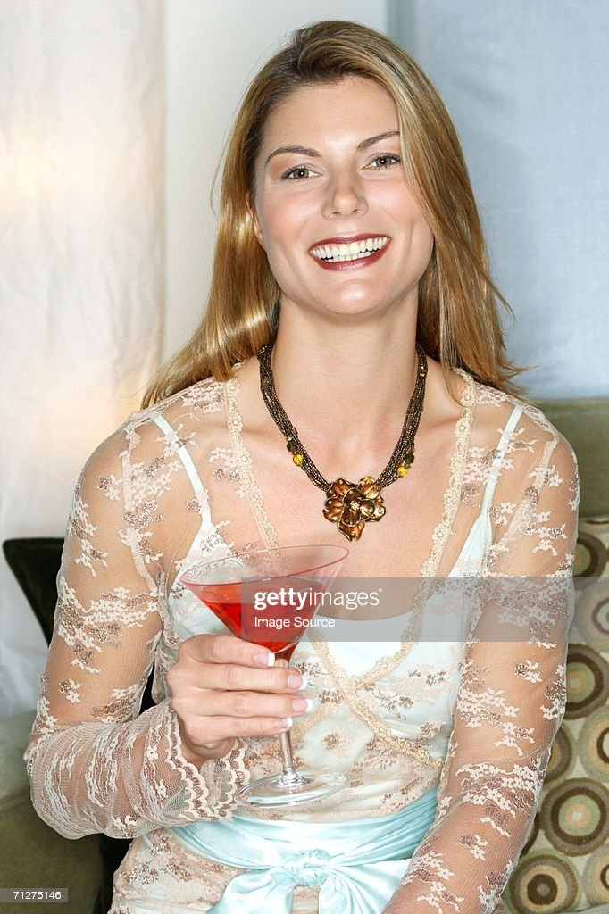 Woman with a cocktail : Stock Photo