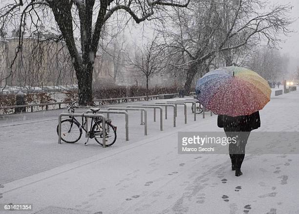 A woman with a colorful umbrella walks on the bank of river Ljublianica on January 13 2017 in Ljubljana Slovenia Most of Slovenia was covered by...