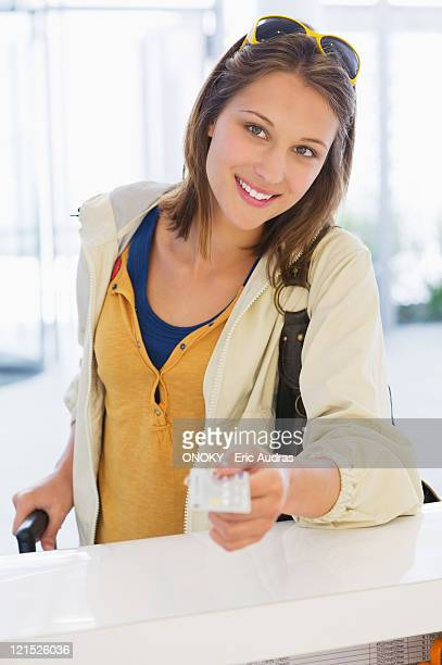 Woman with a credit card at a hotel reception