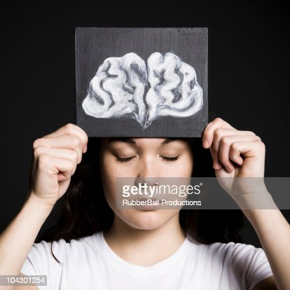 Woman with a drawing of a brain